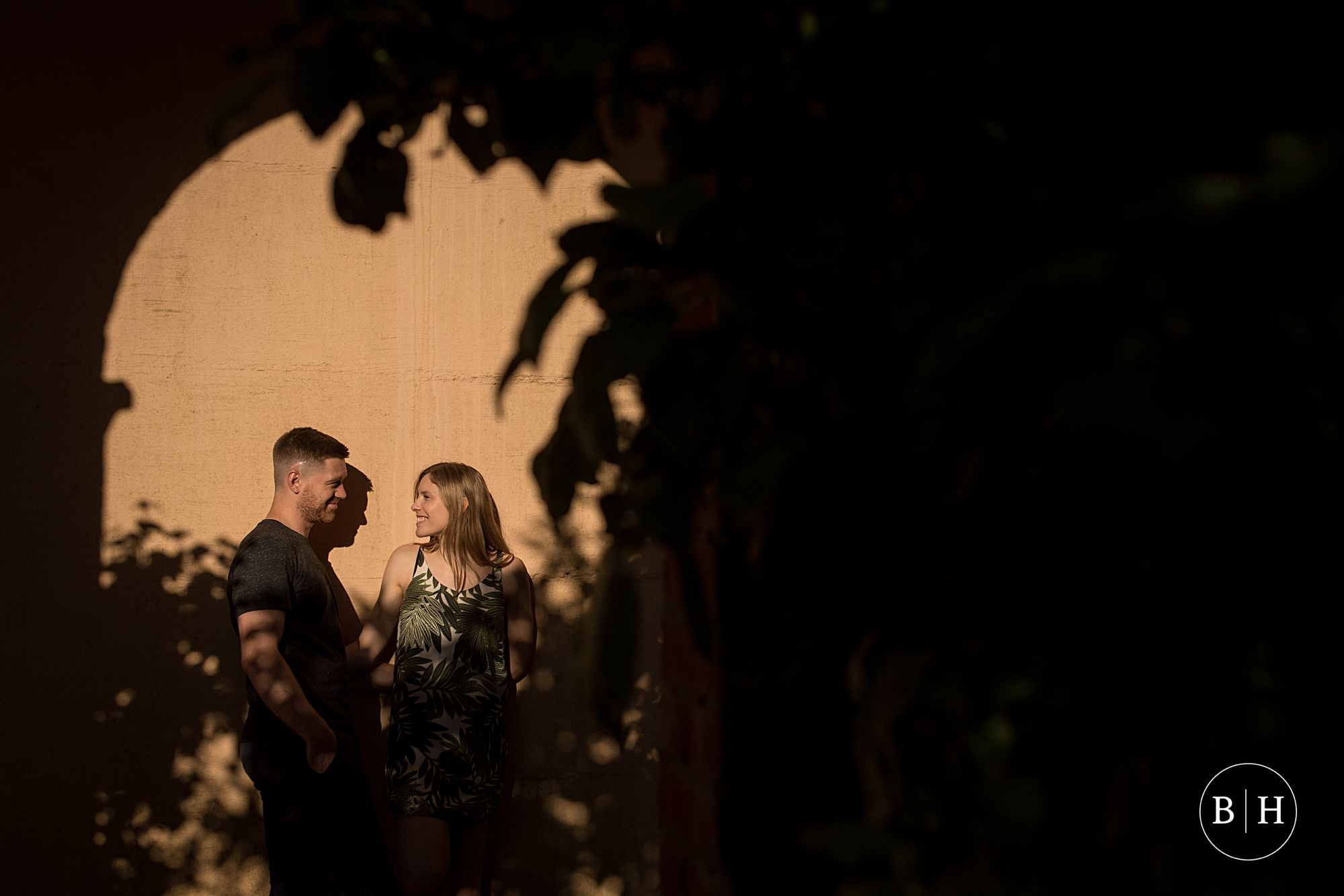 Couple in golden light at Hampstead Pergola and Hill garden
