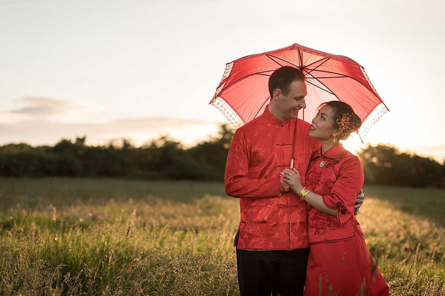 Sunset with bride and groom in traditional Chinese dress at Milling Barn