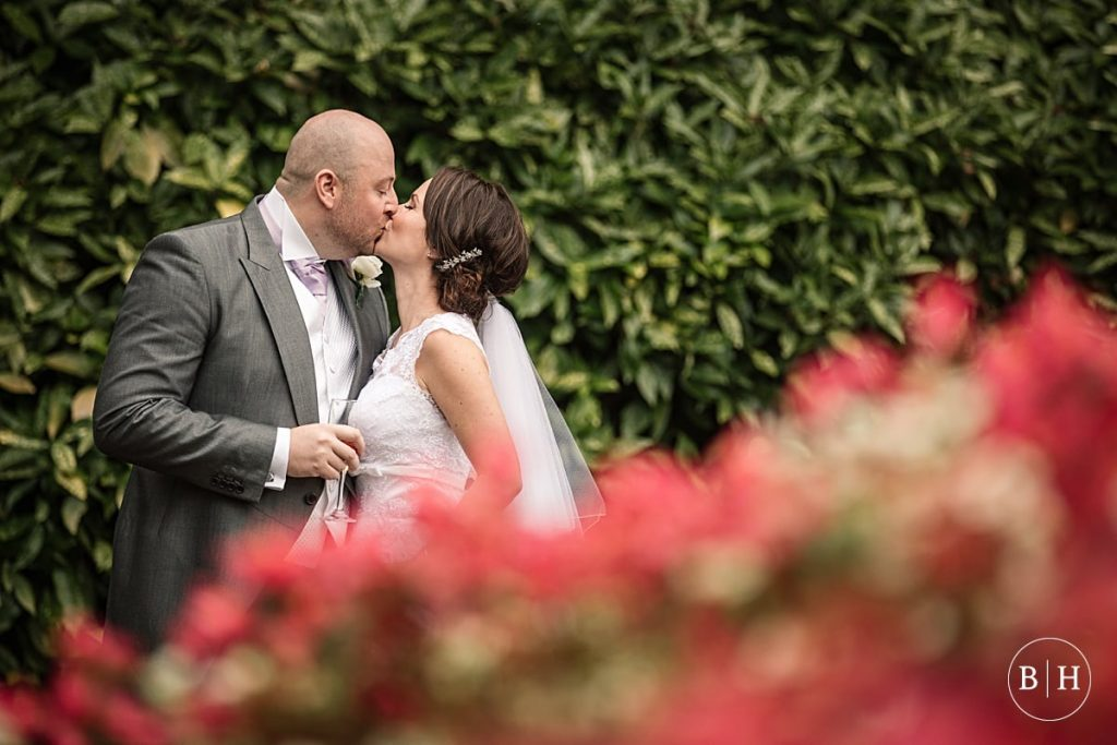 Wedding couple kissing at Waddesdon Dairy, Buckinghamshire. Taken by Becky Harley Photography