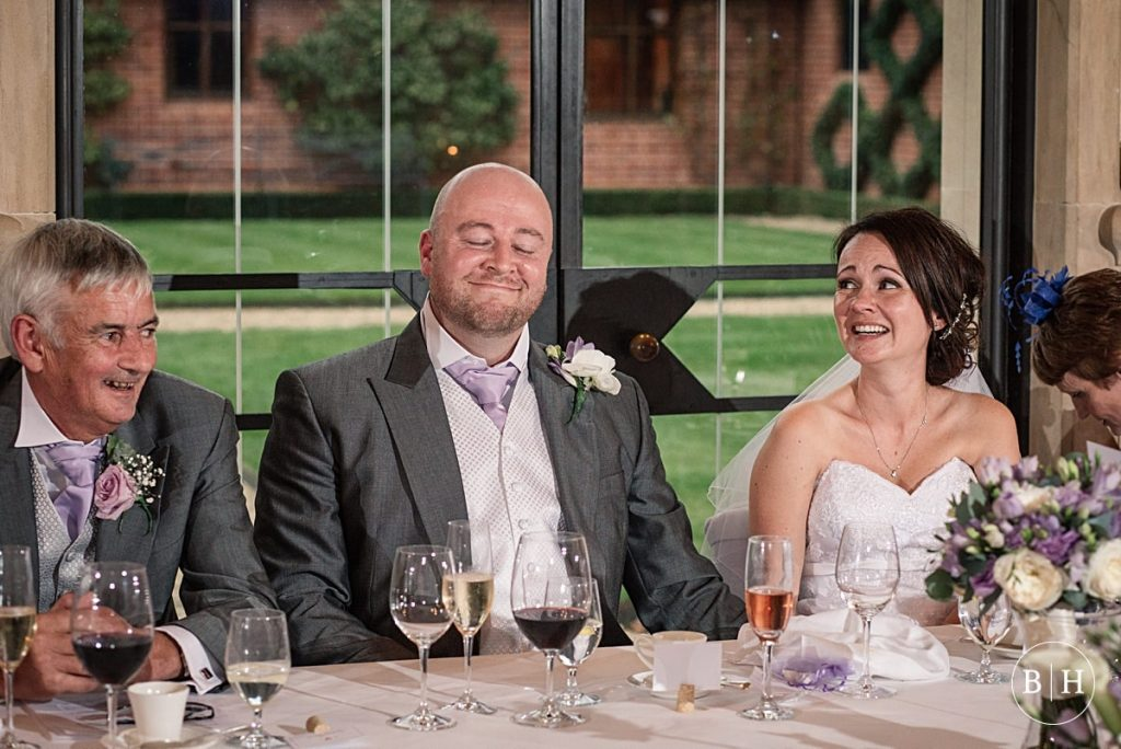 Bride and Groom reacting to wedding speeches at Waddesdon Dairy in Buckinghamshire. Taken by Becky Harley Photography