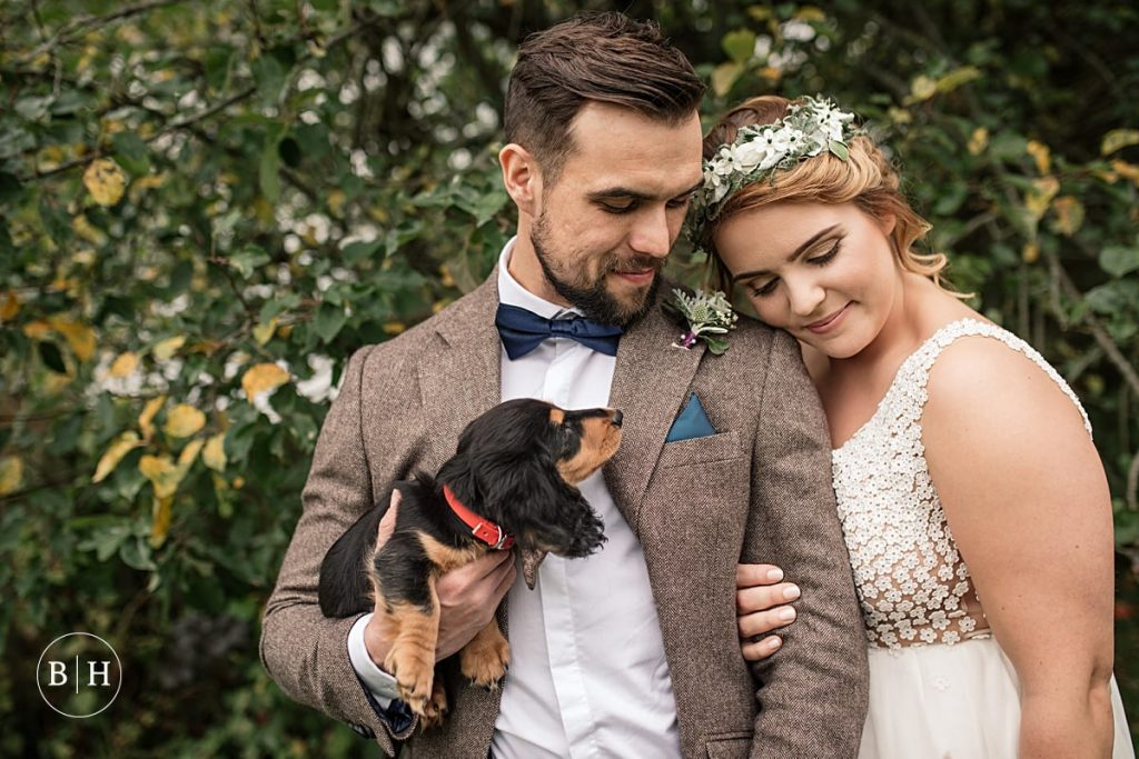Bride and Groom with dachsund puppy taken by Becky Harley Photography