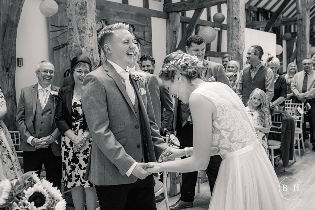 Bride and groom laughing and exchanging vows at the Henry Moore Foundation taken by Becky Harley Photography