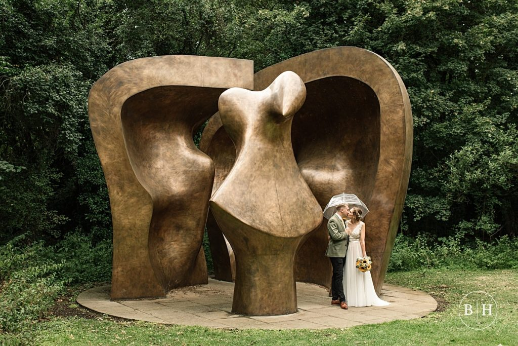 Henry Moore's Figure in the Shelter with bride and groom taken by Becky Harley Photography