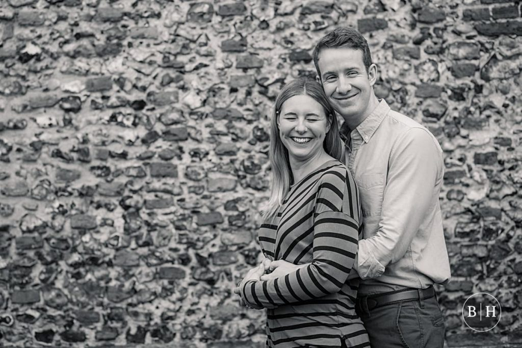 Engaged couple hugging at Sopwell Nunnery in St Albans taken by Becky Harley Photography