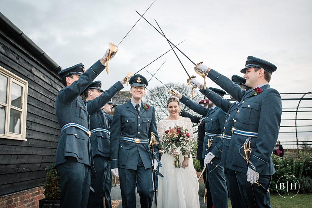 Bride and Groom guard of honour at Milling Barn, aken by Becky Harley Photography