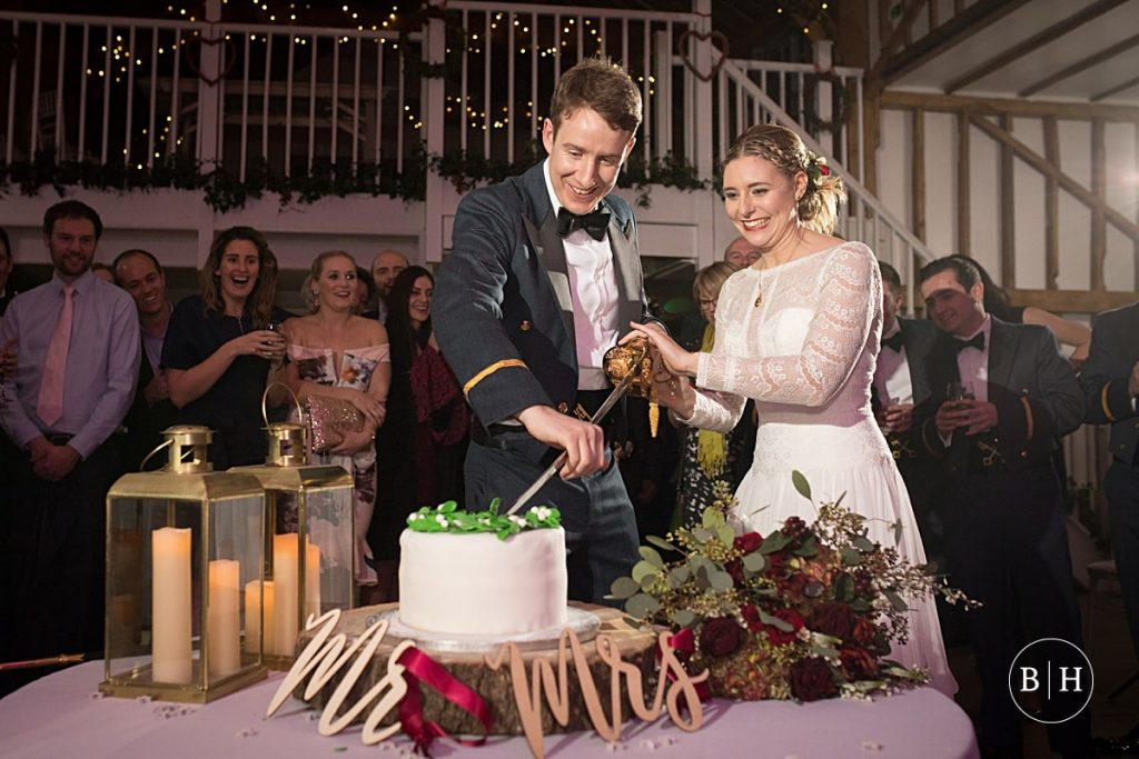 Bride and groom cutting the cake at Milling barn aken by Becky Harley Photography