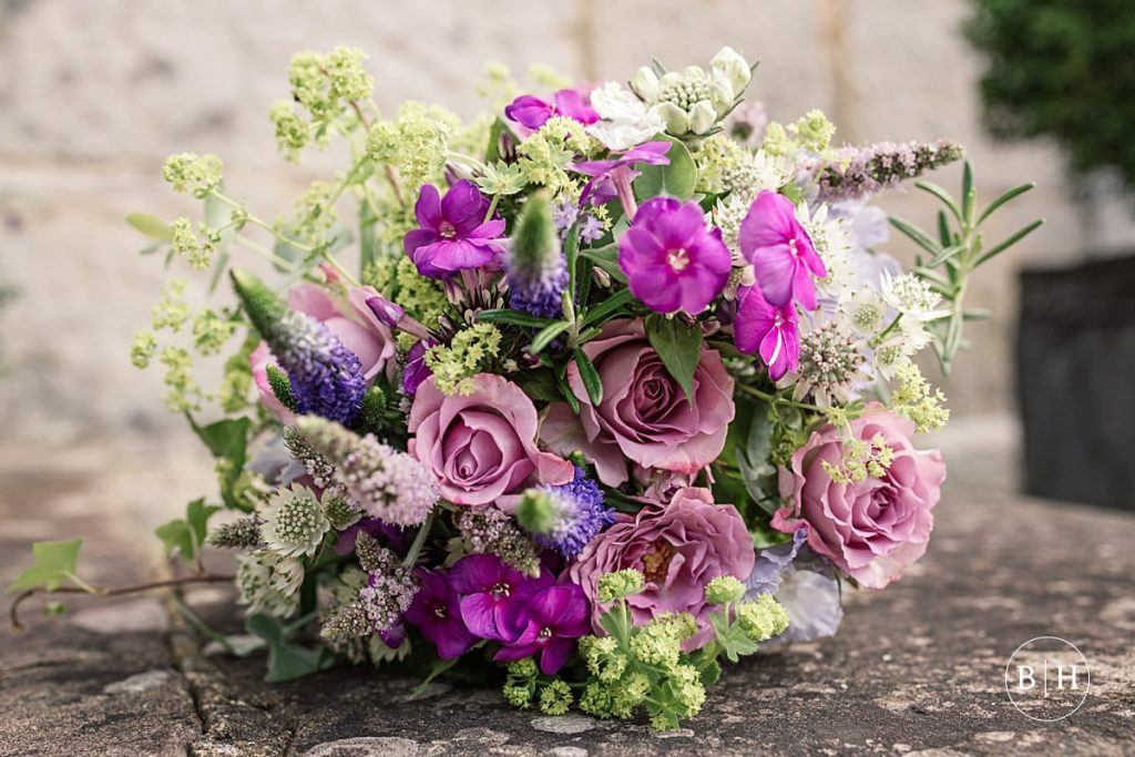 Purple wedding bouquet. How to book your wedding florist
