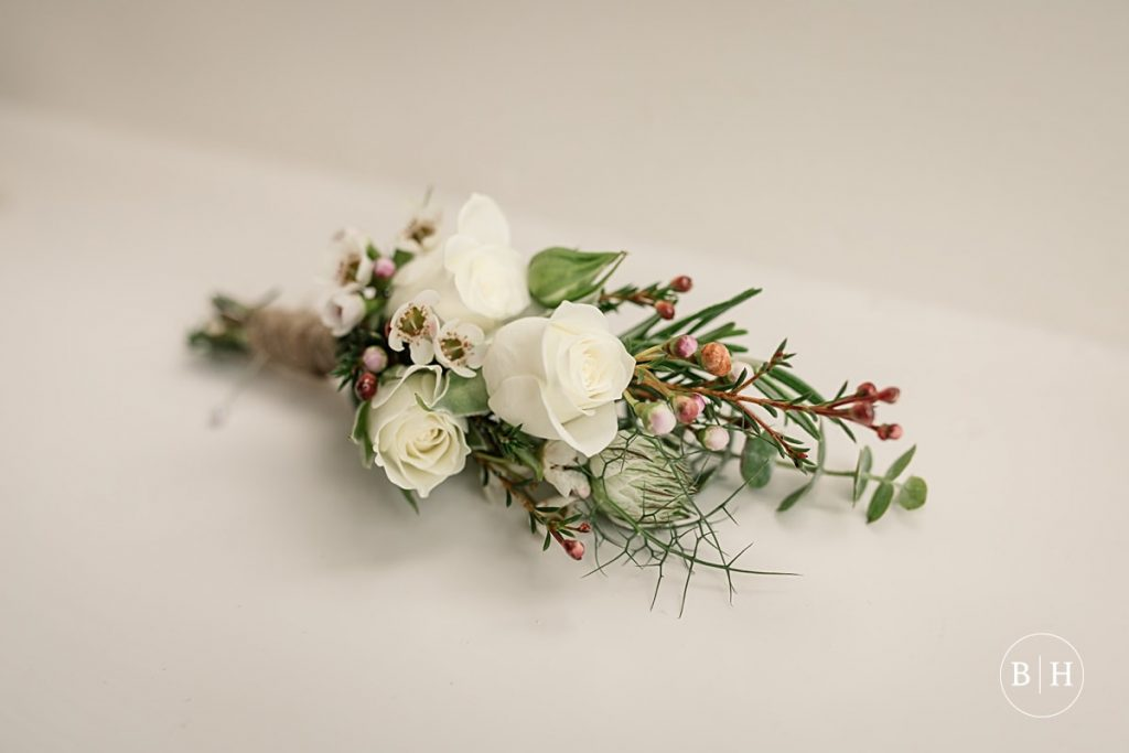 Delicate wedding buttonhole. How to book your wedding florist