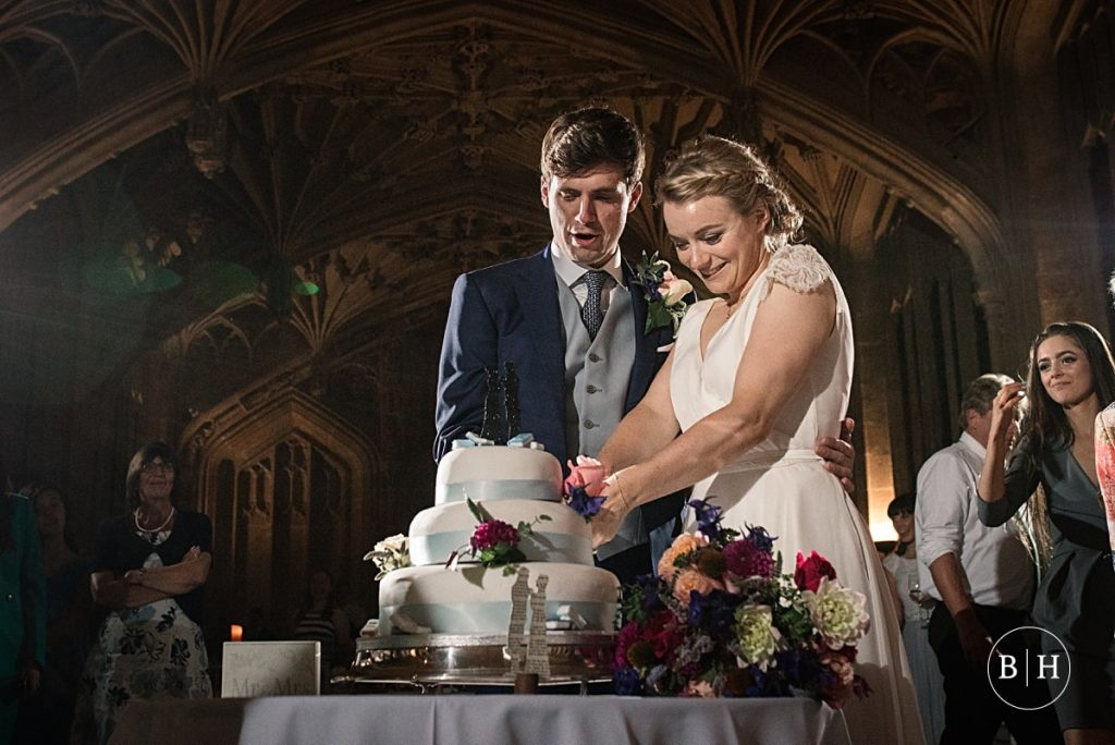 Bride and groom cutting wedding cake at Bodleian Library Wedding taken by Becky Harley Photography