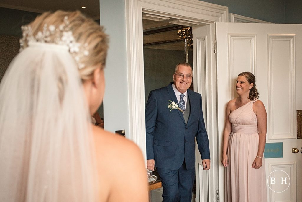 Bride's father seeing her for the first time at Pendrell Hall taken by Becky Harley Photography