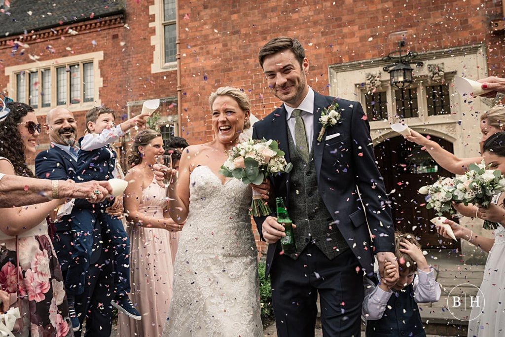 Bride and Groom during confetti throw at Pendrell Hall taken by Becky Harley Photography