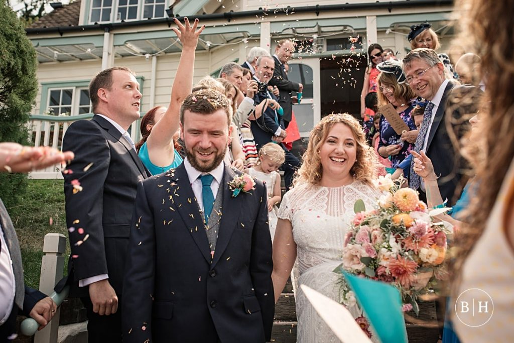 Bride and groom during confetti throw at Whitstable Wedding taken by Becky Harley Photography