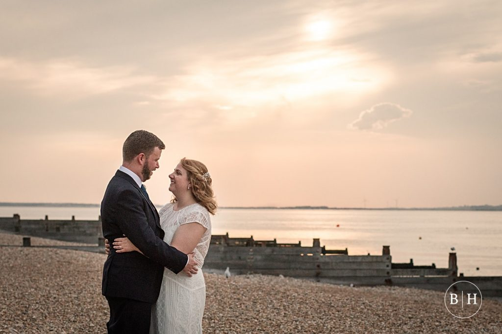 Bride and groom on the beach at Whitstable Wedding taken by Becky Harley Photography