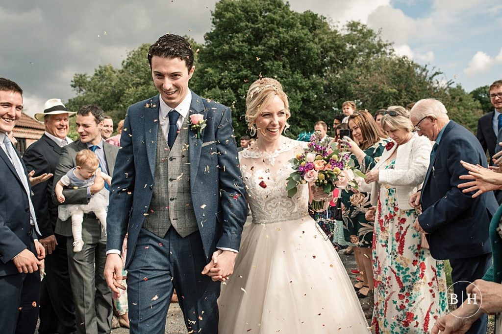 Bride and Groom with confetti at Coltsfoot Country Retreat Wedding taken by Becky Harley Photography
