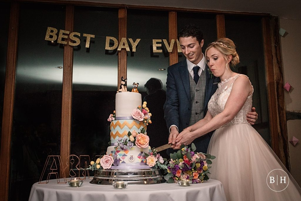 Bride and Groom cutting the cake at Coltsfoot Country Retreat Wedding taken by Becky Harley Photography