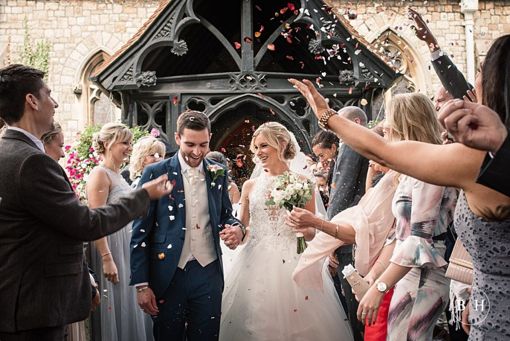 Bride and groom with confetti at Riverside marquee wedding taken by Becky Harley Photography