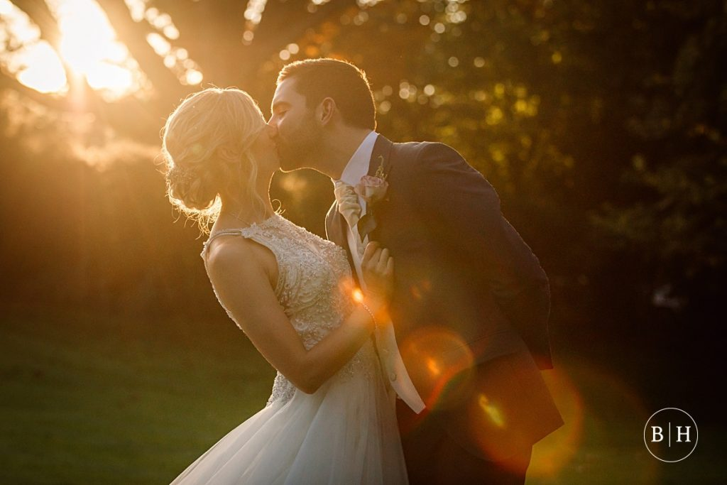 bride and groom in golden light Riverside marquee wedding taken by Becky Harley Photography