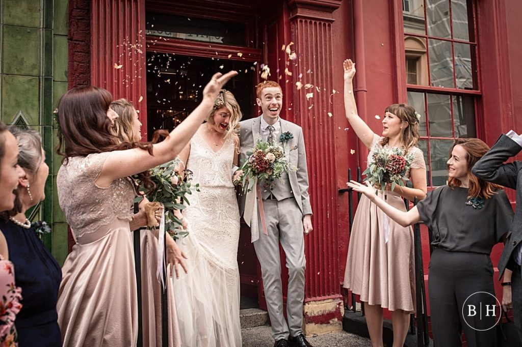 bride and groom with confetti at Soho union club wedding taken by Becky Harley Photography
