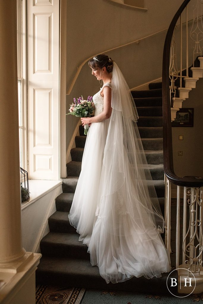 bride by window at Theobalds Estate Wedding taken by Becky Harley Photography