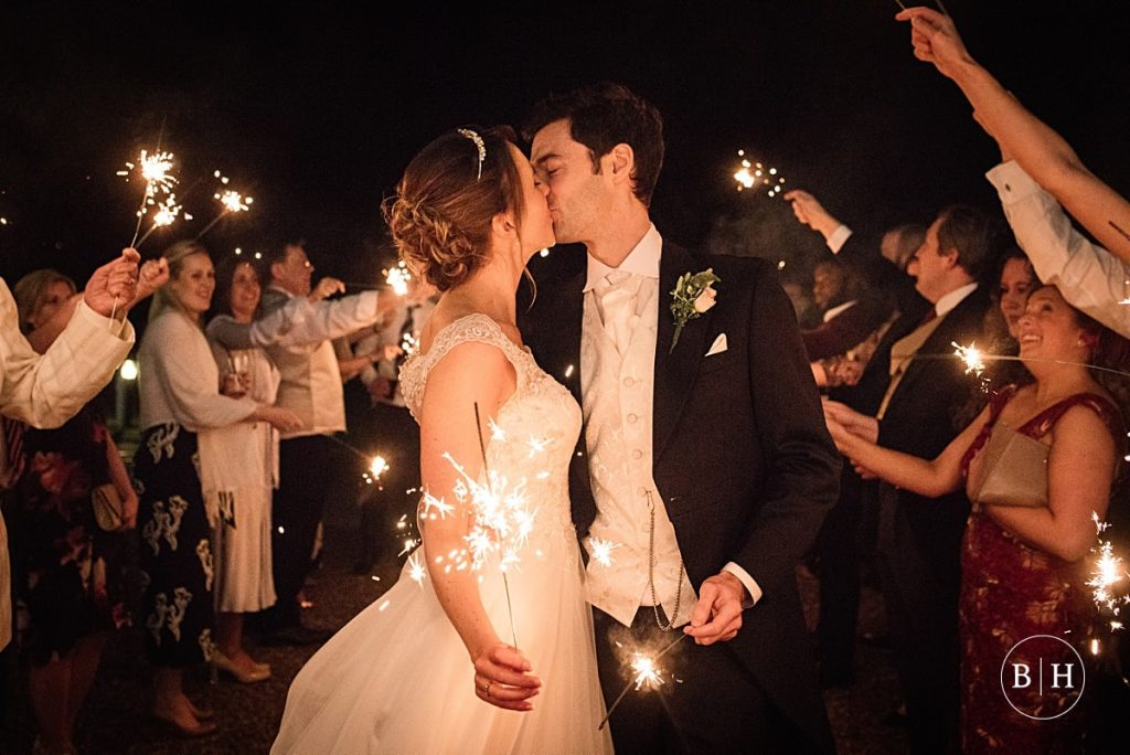 Bride and Groom with sparklers at Theobalds Estate Wedding taken by Becky Harley Photography