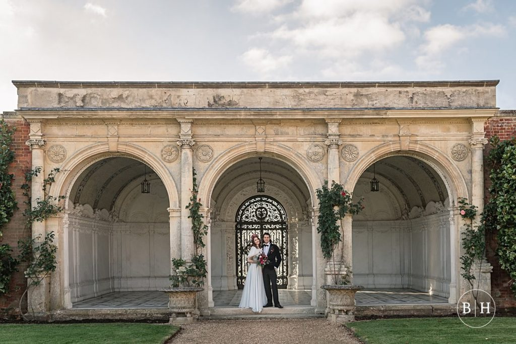 Bride and Groom in the loggia at North Mymms Park  - North Mymms Park Wedding Photography, taken by Becky Harley Photography