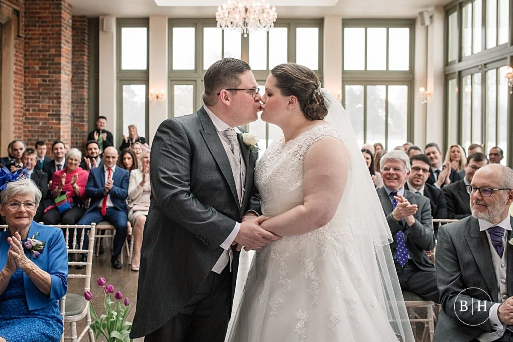 bride and groom first kiss at Offley Place, Hertfordshire, , taken by Becky Harley Photography