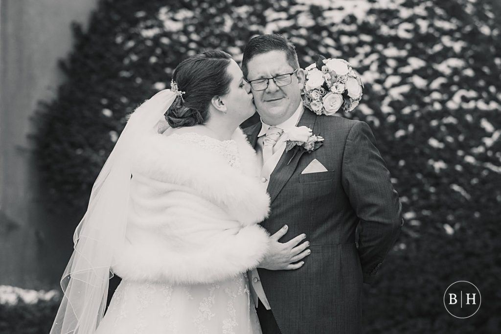 bride and groom in the snow at Offley Place, taken by Becky Harley Photography
