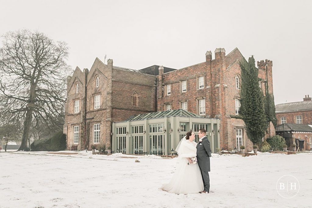 bride and groom in the snow at Offley Place, Hertfordshire, taken by Becky Harley Photography