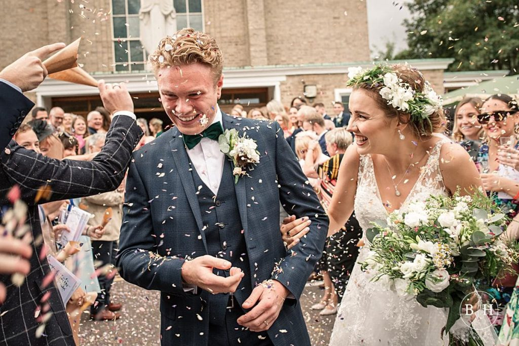 Bride and groom with confetti at Offley Place Wedding taken by Becky Harley Photography