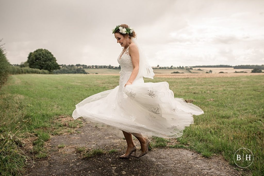 bride twirling in dress at Offley Place Wedding taken by Becky Harley Photography