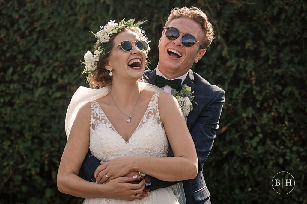Bride and groom in sunglasses at Offley Place Wedding taken by Becky Harley Photography