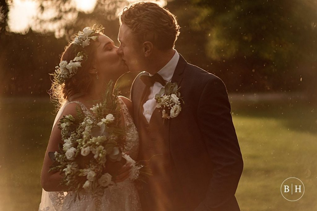bride and groom at sunset at Offley Place Wedding taken by Becky Harley Photography
