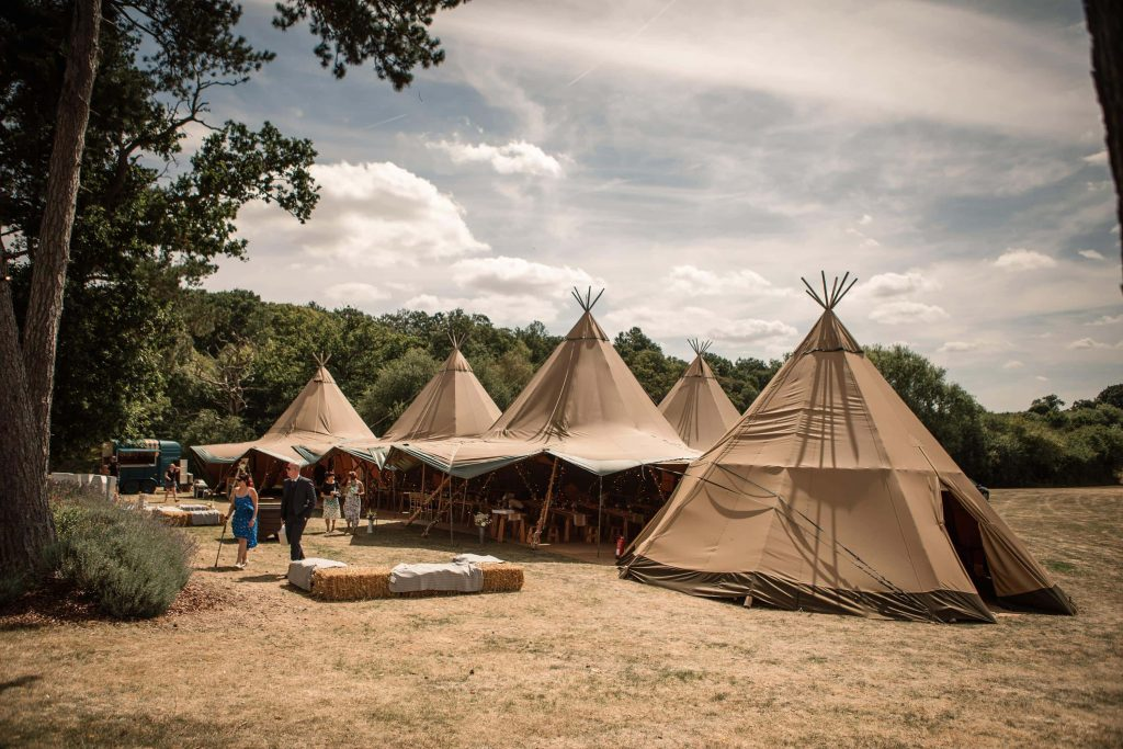 Tipi set up at Brook Farm Cuffley Wedding taken by Becky Harley Photography