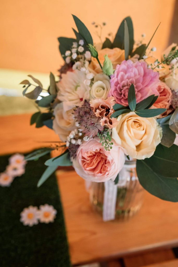 Peach and blush flowers at Brook Farm Cuffley Wedding taken by Becky Harley Photography
