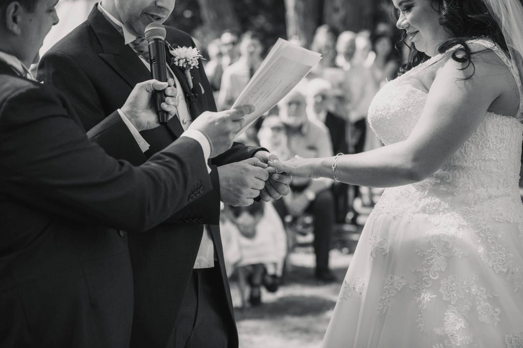 Bride and groom exchanging rings at Brook Farm Cuffley Wedding taken by Becky Harley Photography