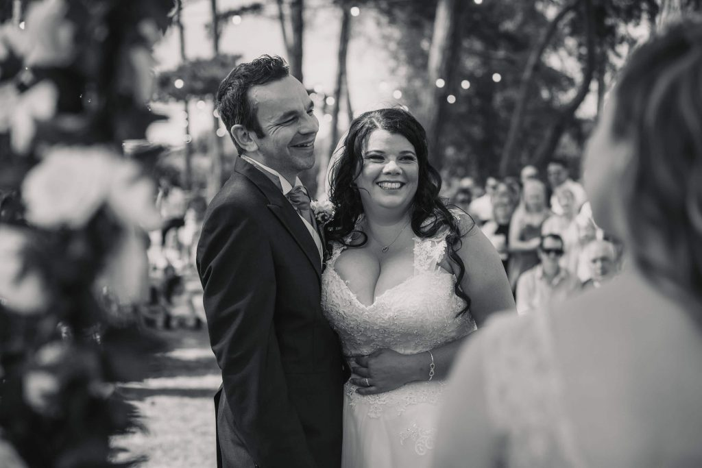 Bride and groom smiling at Brook Farm Cuffley Wedding taken by Becky Harley Photography
