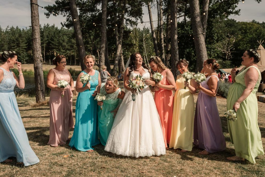 Bride and bridesmaids at Brook Farm Cuffley Wedding taken by Becky Harley Photography