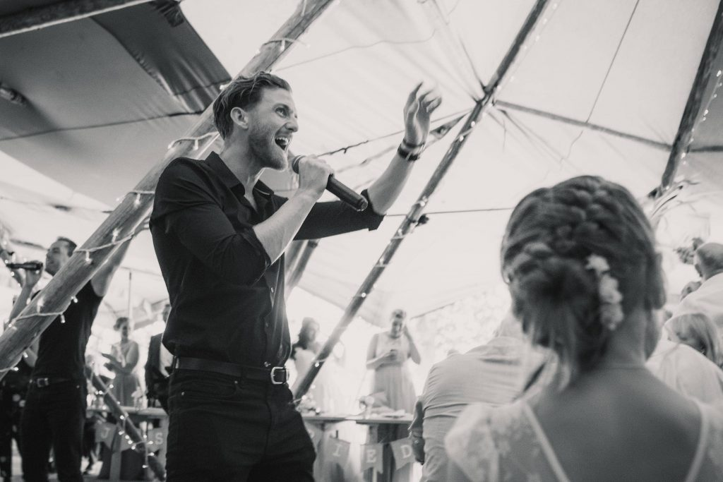 singing waiters at Brook Farm Cuffley Wedding taken by Becky Harley Photography
