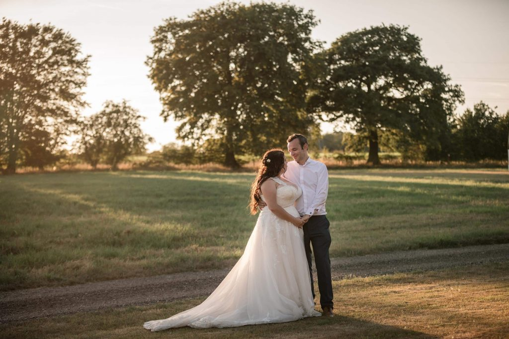 bride and groom in golden sun at Brook Farm Cuffley Wedding taken by Becky Harley Photography