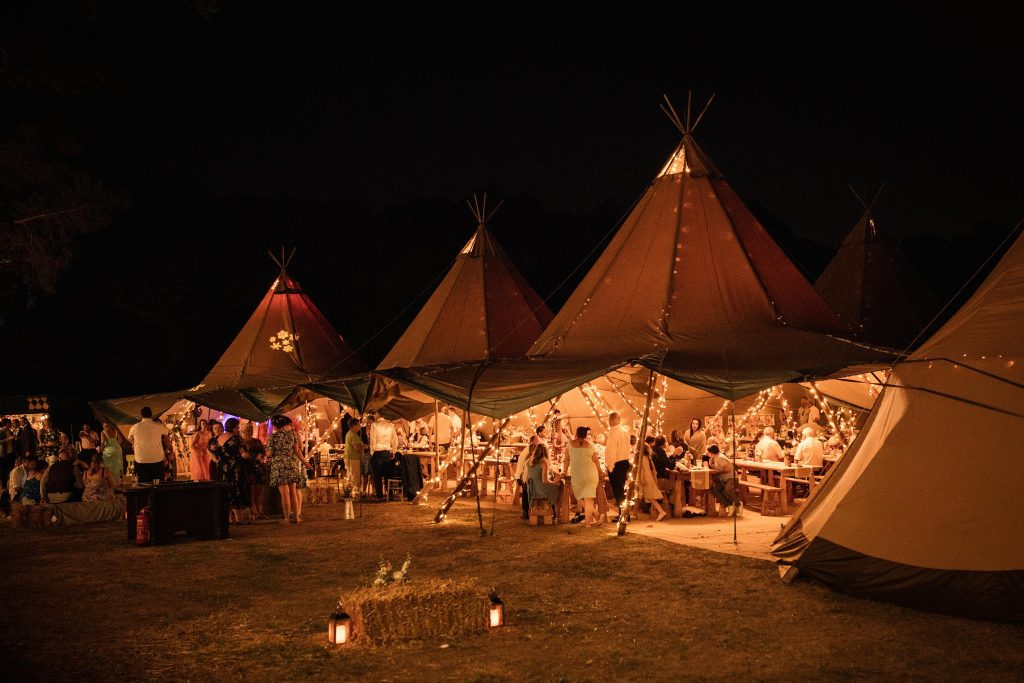 Tipi by night at Brook Farm Cuffley Wedding taken by Becky Harley Photography