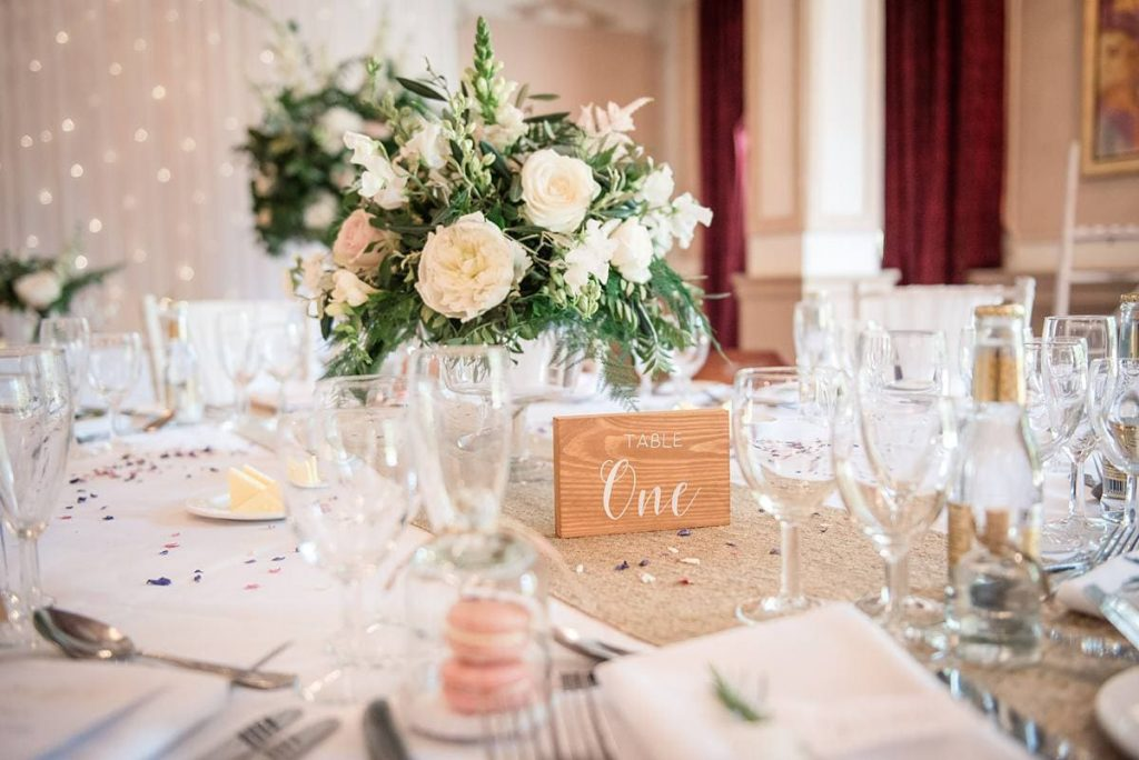 blush tone table centres with flowers at Down Hall wedding taken by Becky Harley Photography