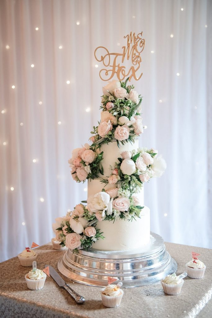 four tiered wedding cake at Down Hall wedding taken by Becky Harley Photography