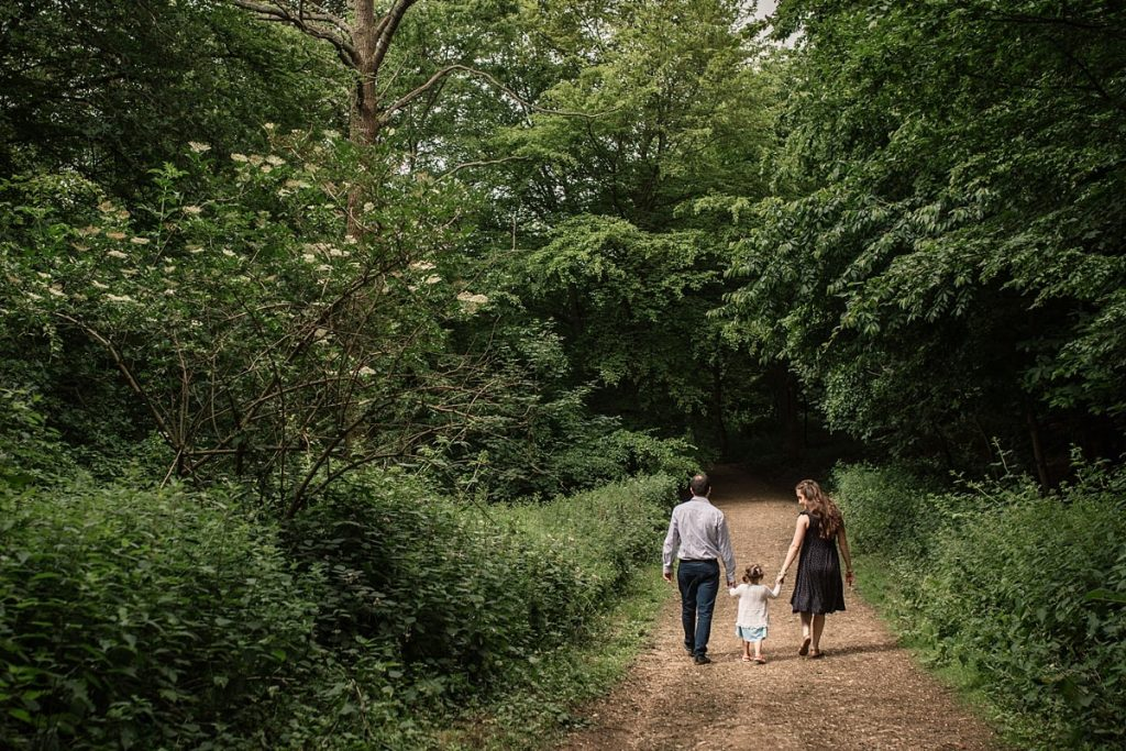 parents and toddler walking in hertfordshire family portraits taken by Becky Harley Photography