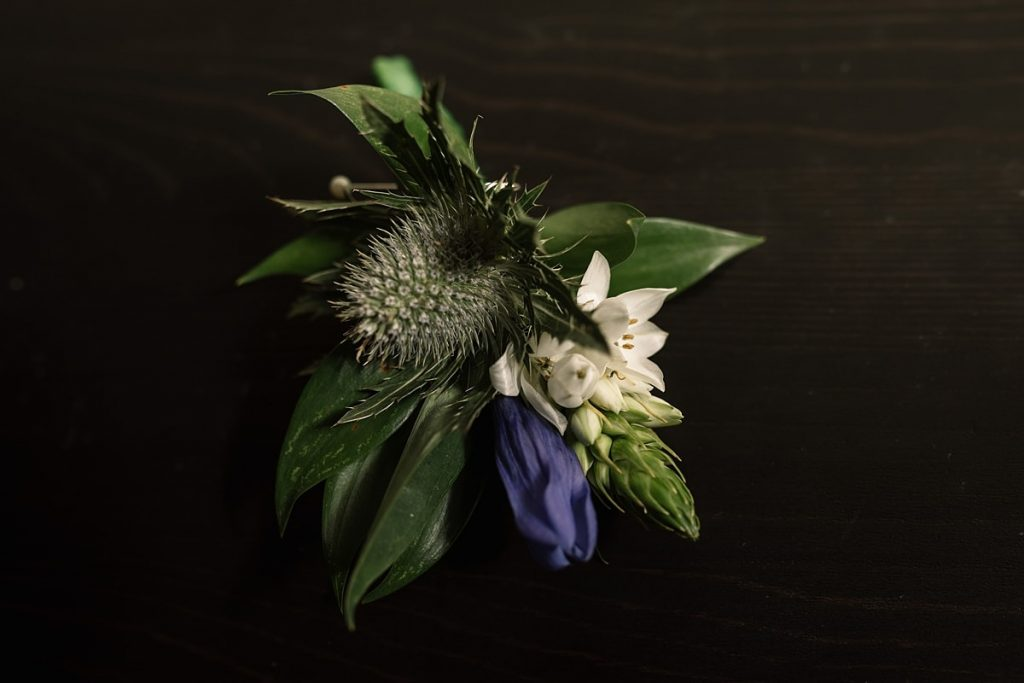 Thistle wedding buttonhole at summer Milling Barn wedding, taken by Becky Harley Photography