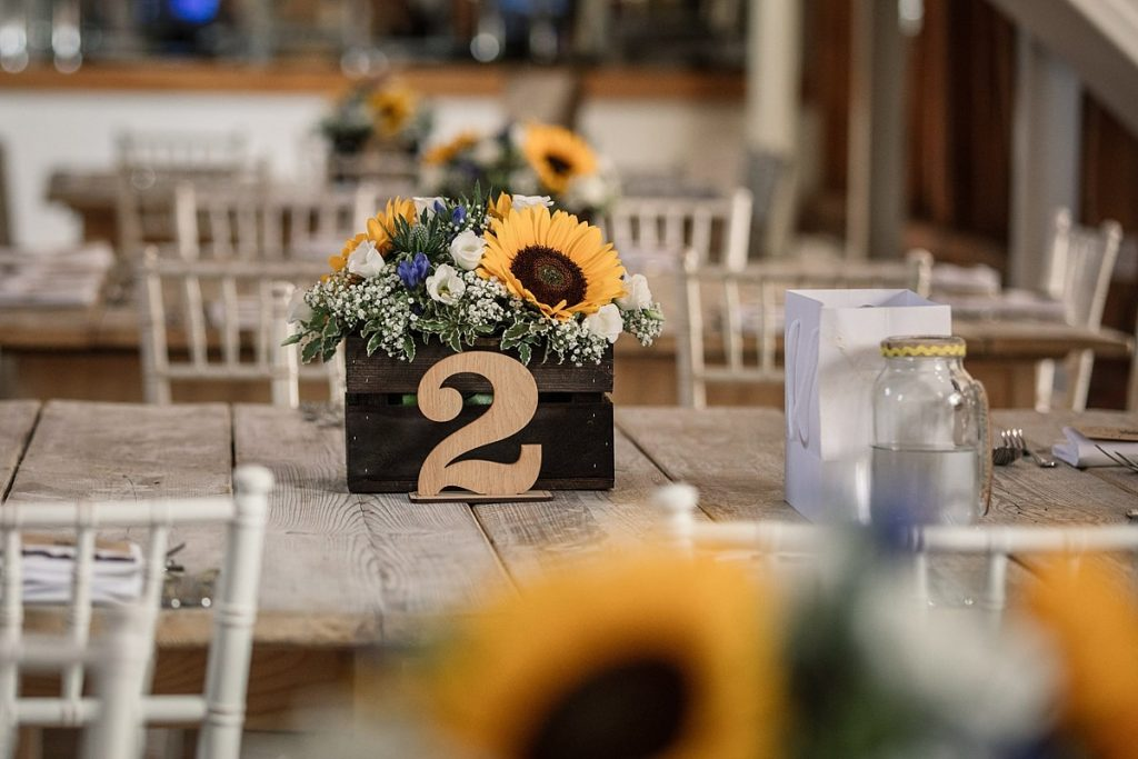 Sunflower table centres at summer Milling Barn wedding, taken by Becky Harley Photography