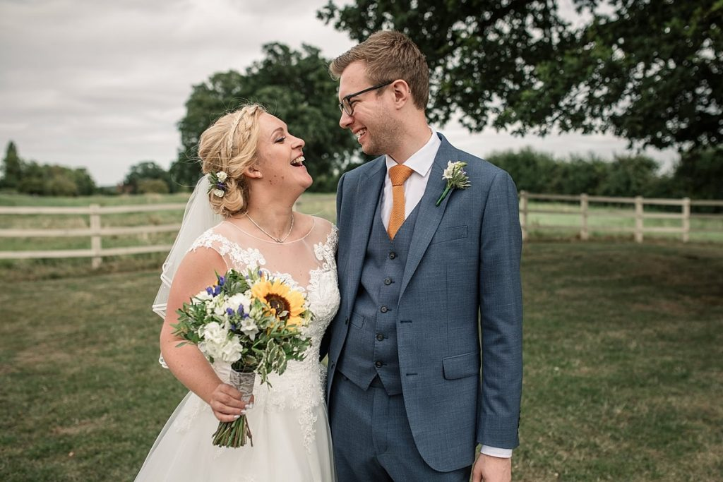 bride and groom laughing at summer Milling Barn wedding, taken by Becky Harley Photography