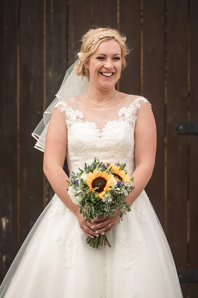 beautiful bride with sunflower bouquet at summer Milling Barn wedding, taken by Becky Harley Photography