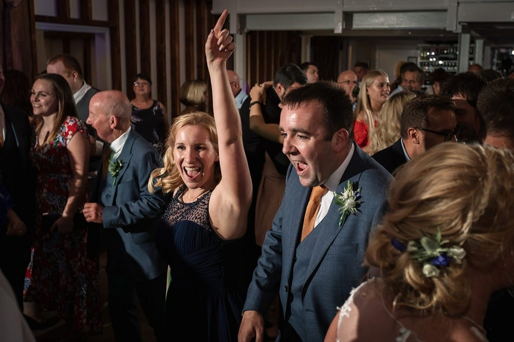 guests dancing at summer Milling Barn wedding, taken by Becky Harley Photography