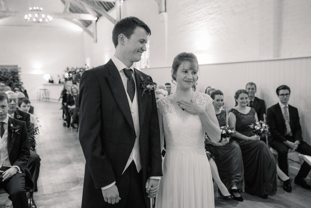 Bride and groom during ceremony at Alswick Barn wedding in Buntingford, taken by Becky Harley Photography