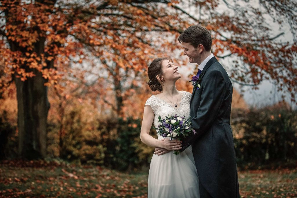 Bride and groom with autumn leaves at Alswick Barn wedding in Buntingford, taken by Becky Harley Photography